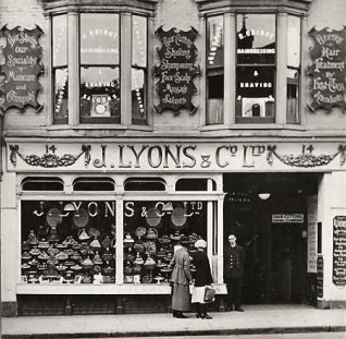 Undated photograph of J. Lyons & Co's tea room at 14 North Street, Brighton. The company's tea rooms were hugely popular. They were also known for the care taken in the design and decoration of their shops. In spite of its success throughout much of the century, Lyons & Co's fortunes declined in the late 1960s. By the early 1980s, the company had been broken up and sold to various buyers. | Royal Pavilion and Museums Brighton and Hove