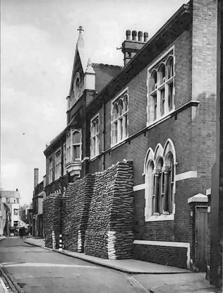 This photographic print was made by the Borough Surveyor's department. It shows the Public Assistance Office in Prince's Street, Brighton. The entrance to the building is flanked by sandbags.  This print was made as part of a record of local provisions against air attack. War with Germany had been declared less than two weeks before this photograph was taken.  The building was originally constructed as the Parochial Office for Brighton's Guardians of the Poor. This was an elected board that was responsible for the welfare of the poor in Brighton. One of its most important roles was overseeing local workhouses. After the Guardians of the Poor were dissolved, the building was used by a variety of organisations. In addition to its use for Air Raid Precautions, it also served as a temporary home for the magistrate's court between 1986 and 1989. The building has since been converted into flats.  Transfer | Reproduced courtesy of Royal Pavilion, & Museums, Brighton & Hove