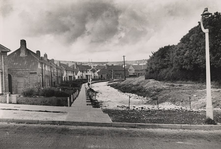 This photographic print was made by the Borough Surveyor's department on 28 August 1950. It shows Coldean Lane and Forest Road during work on the extension of the Parkside Estate. This housing estate is situated in Coldean, Brighton. | Reproduced courtesy of Royal Pavilion, Libraries & Museums, Brighton & Hove