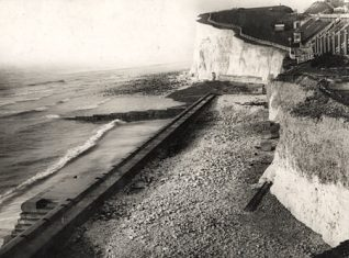 Saltdean 23 December 1932: This photographic print was made by Brighton's Borough Surveyor's department in December 1932. It shows Saltdean's sea defences during improvement work. The new sea defence wall is in the centre with steps running down to beach level. | Reproduced courtesy of  Royal Pavilion, Libraries & Museums, Brighton & Hove