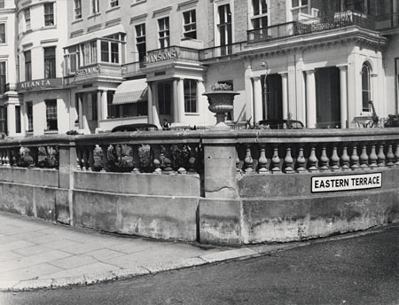 This photographic print made by the Borough Surveyor's department in about 1950. It shows the corner of Eastern Terrace, Brighton. Steyning Mansions can be seen behind the low wall. | Reproduced courtesy of Royal Pavilion, Libraries & Museums, Brighton & Hove