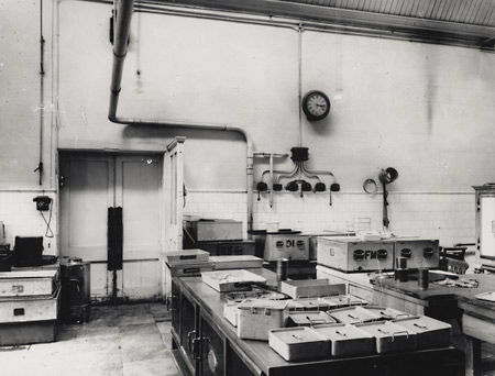 This photographic print was made by the Borough Surveyor's department. It shows the interior of a kitchen in Brighton General Hospital on Elm Grove, Brighton.  Brighton General Hospital began as the Brighton Workhouse and Infirmary in 1865-7, and became Brighton Municipal Hospital in 1938. In May 1948 it was renamed Brighton General Hospital. The hospital came under the control of the Ministry of Health in June 1948 following the introduction of the National Health Service Act. The photograph may have been taken as a record of conditions around this time. | Reproduced courtesy of Royal Pavilion, Libraries & Museums, Brighton & Hove