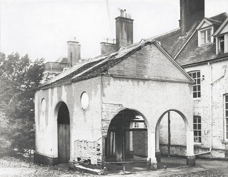 This photographic print shows a horse gin by Stanmer House, Brighton. The structure is clearly in a dilapidated condition.  The photograph was commissoned by the Borough Surveyor's department of Brighton Borough Council. It was amongst a number taken of the area, which were presumably used to survey the condition of the buildings prior to their demolition. | Reproduced courtesy of Royal Pavilion and Museums Brighton and Hove