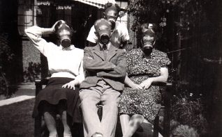 Harris family in gasmasks. Gordon Harris is at the back. | From the Letter in the Attic collection