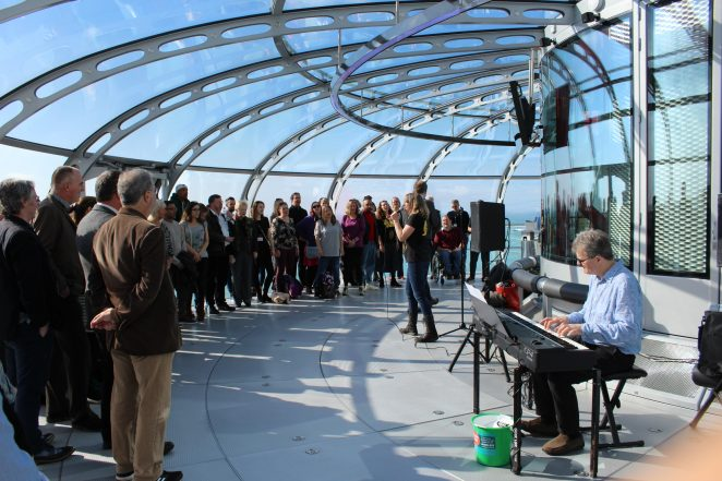 'The choir with no name' on the British Airways i360 - click on image to open larger version | Brighton Housing Trust