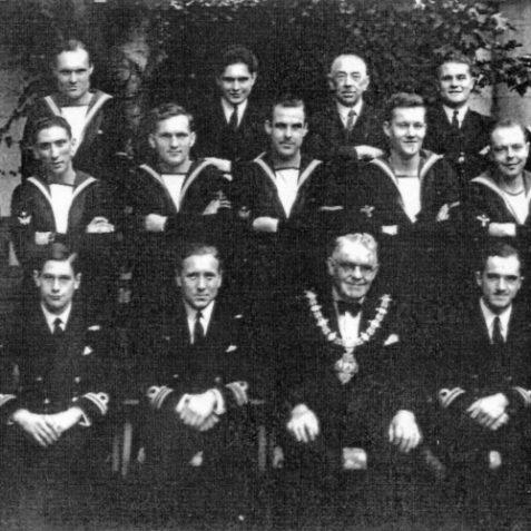 Lieutenant-Commander Edward 'Tedddy' Woodward, DSO, RN (front row third from left) with members of Unbeaten's crew pose with the Mayer of Hove Councillor A. H. Clarke. | Photo: From the private collection of Mrs B. Woodward.