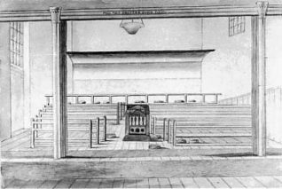 Inside the Meeting House. The shutter in the picture was pulled down to make a special meeting room for children. The Meeting House was heated by a coke stove in the centre of the room. The high windows were to stop any distraction from silent worship. | Sketch by W.A. Delamotte, 1853