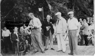 The schoolboy caddying for Bill Spence is John Stenning a long time member of the golf club. | Courtesy of John Stenning