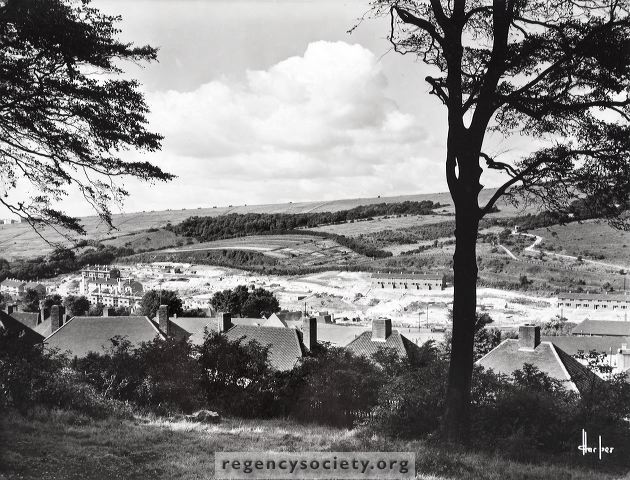 This truly lovely photograph by a professional photographer (Harper of Hove) shows the construction of the Bates Estate in its early stages. It was taken for the Brighton Corporation in the summer of 1952 from a standpoint in the copse behind Birdham Road. The estate took its name from the Nursery which formerly occupied this extensive site. In the far distance can be seen part of the Hollingdean estate, which was being built at the same time. | Image reproduced with kind permission of The Regency Society and The James Gray Collection