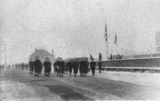 Cadet Ratings march past the Quarterdeck on the South Road behind Hove Marina; these men were in the final stage of their training before being granted a commission. | From a private collection
