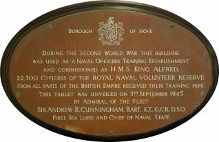 Plaque commemorating the war time ruse of the Hove Marina complex as the Royal Navy's Officer Training Establishment H.M.S. King Alfred. | Photo by Tony Mould by kind permission of Brighton & Hove Council