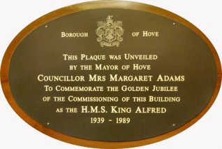 Plaque commemorating the Golden Jubilee of the commissioning of Hove Marina as the Royal Navy's Officer Training Establishment H.M.S. King Alfred in 1939. | Photo by Tony Mould by kind permission of Brighton & Hove Council