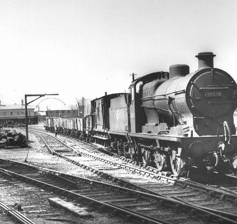 Kemp Town station yard - a view from the tunnel on 13 June 1962 of the daily goods train. Note how all the lines from the yard converge into a single line through the tunnel and onwards to the junction with the main Brighton to Lewes line at Lewes Road.   Photo from private collection of Brian Matthews