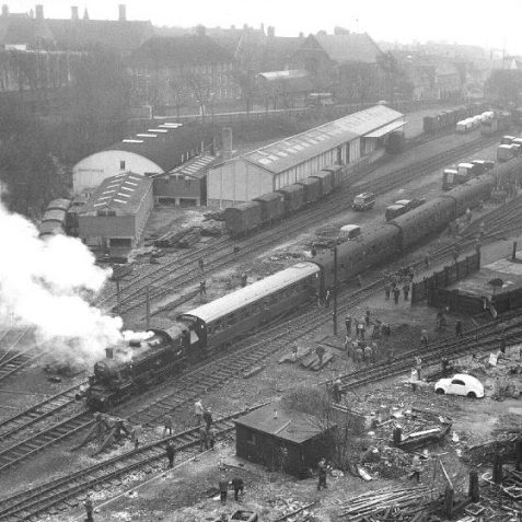Kemp town Station and yard - 22 March 1964 - with a visiting 'Rail Enthusiasts Special'. Brighton College can be seen lying behind Sutherland Road.   Photo from the private collection of Brian Matthews