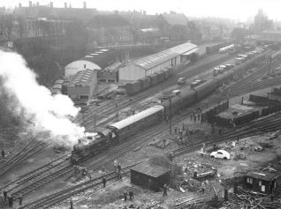 Kemp town Station and yard - 22 March 1964 - with a visiting 'Rail Enthusiasts Special'. Brighton College can be seen lying behind Sutherland Road. Click on the image to see a full-sized version | Photo from the private collection of Brian Matthews