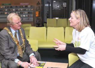 The Mayor of Brighton and Hove, Councillor Geoffrey Wells and the living 'book' he borrowed   Photo by Tony Mould