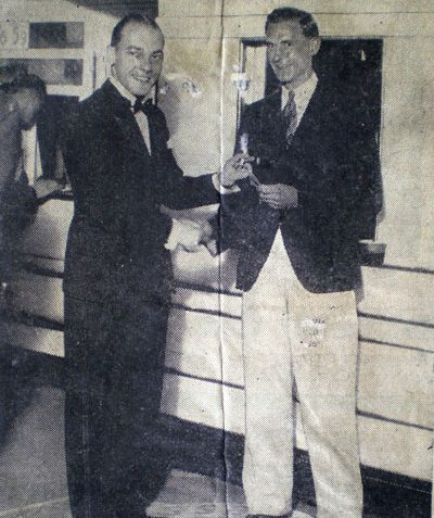 Mr T. Toynbee receiving a free season ticket for being the 100,000th person to see the show