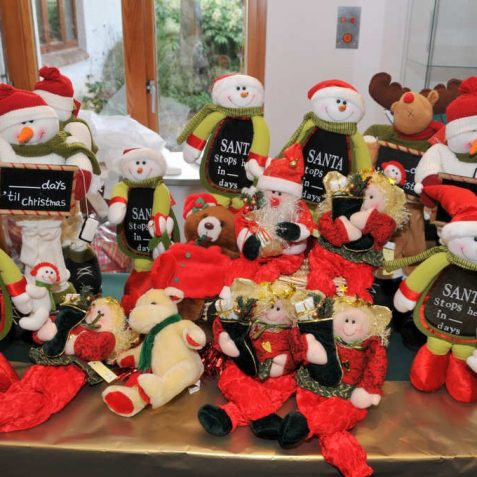 Santas on sale at the Martlets Hospice Christmas Fayre | Photo by Tony Mould