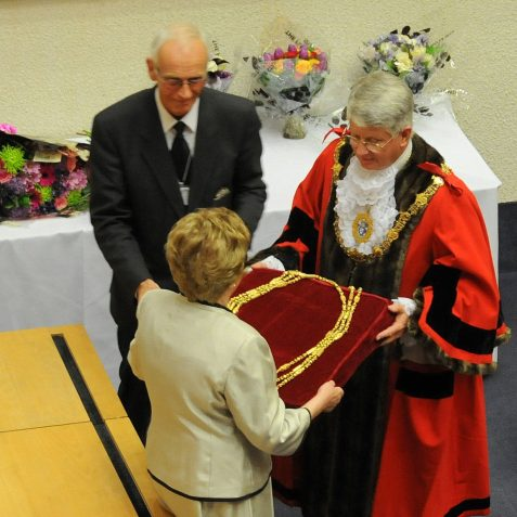 The newly elected Mayor, Councillor Ann Norman is presented with the Mayoral chain of office by the outgoing Mayor, Councillor Garry Peltzer Dunn | Photo by Tony Mould