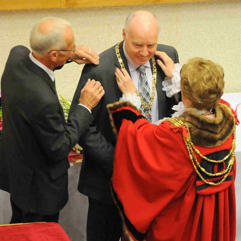 The Mayor presents her Consort, husband Ken Norman, with his chain of office | Photo by Tony Mould