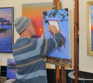 Local artist Philip Dunn demonstrates his work | Photo by Tony Mould