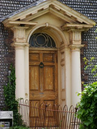The farmhouse has a Doric doorway | Photo by Carol Homeward