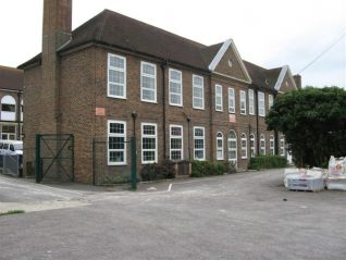 Moulsecoomb Senior Boys' School this end, girls' the other.  The allotments were across the lane at this end of the school.   Also at the foot of that lane was a temporary mortuary, situated up the lane above the allotments. | Photo by Ron Spicer.