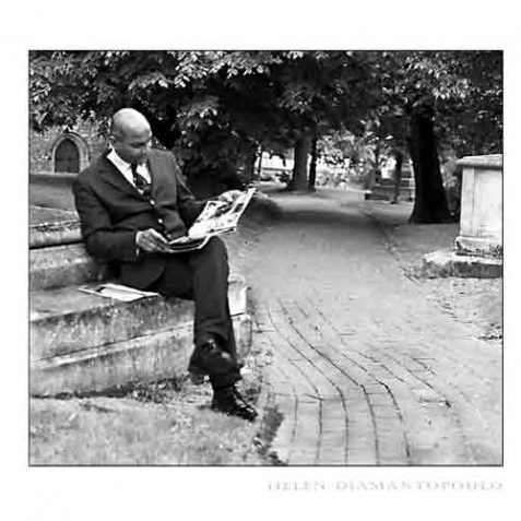 Man reading in St Nicholas Church graveyard | Photo by Helen Diamantopoulo