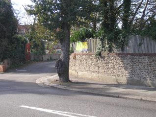 The old flint wall indicates the original route before the developement of Olive Road | Photo by Peter Groves