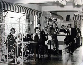 In this photo Mrs Arnold is enjoying a drink with Mr Benny Lee (Managing Director) and guests.  Directly behind her to right is Mr Bill Gentry the General Manager.   Sports Stadium Brighton Archive