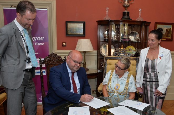 Leader of the Council, Cllr Warren Morgan signs the charter | ©Tony Mould; all images copyrighted