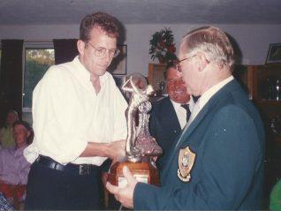 Multiple Club Champion Paul Betteridge receiving the Brighton Open Scratch Trophy from Captain Reg Morton | HPGC Archive