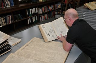 Paul shows some of the many resources available at the History Centre | Photo by Tony Mould
