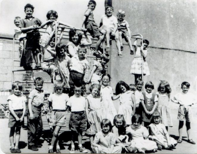 Miss Payne in centre of climbing frame with her class, year not known | From the private collection of C.West