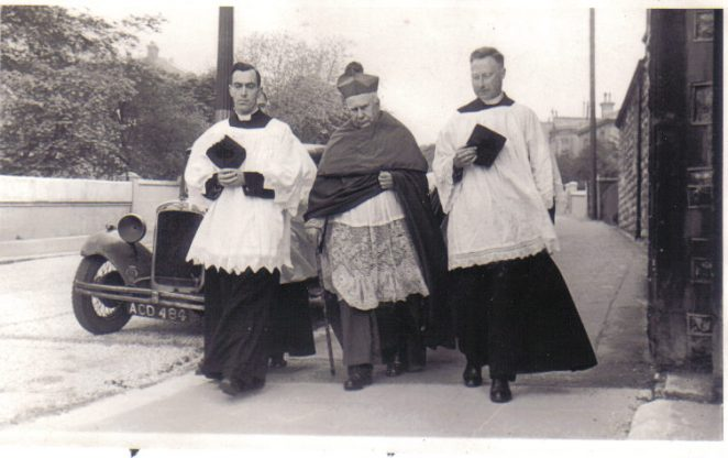 Pictured left to right are Father Pepper, Archbishop Peter Amigo and Father Munns. | From the private collection of Kathy Nichols