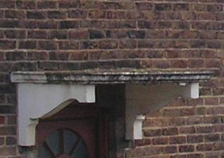 Stonework over portico, Stapley Road | Photo by Peter Groves