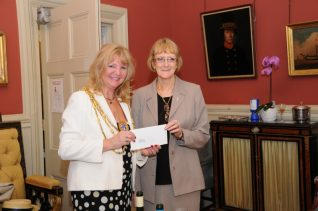 Jennifer receives our donation from The Mayor | Photo by Tony Mould