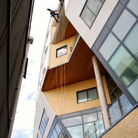Holy abseiling Batman - this is a long way up! | Photo by Tony Mould