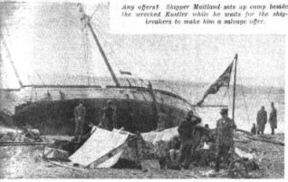 Shipwrecked family camping on Brighton Beach with their beached boat, 'Rustler' in 1952 | Photo supplied by Arthur Loosley, Brighton and Hove Herald