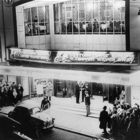 This photo shows the evening of a charity screening of Doctor at Large starring Dirk Bogarde in 1957. The regular programme at the time featured a film starring Tyrone Power. Diners can clearly be seen in the first floor restaurant. | Image reproduced with kind permission of The Royal Pavilion and Museums Brighton and Hove