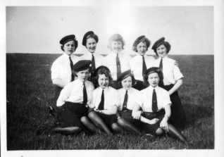 A group of nine Wren Officer's Stewards at HMS Vernon pose for their photo; Lois is in the back row far right. Click on photo to open large image in new window. | From the private collection of Nick Lade