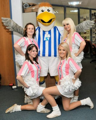 'Gully' the Brighton and Hove Albion mascot, with four of his gorgeous 'Gully's Girls' | Photo by Tony Mould