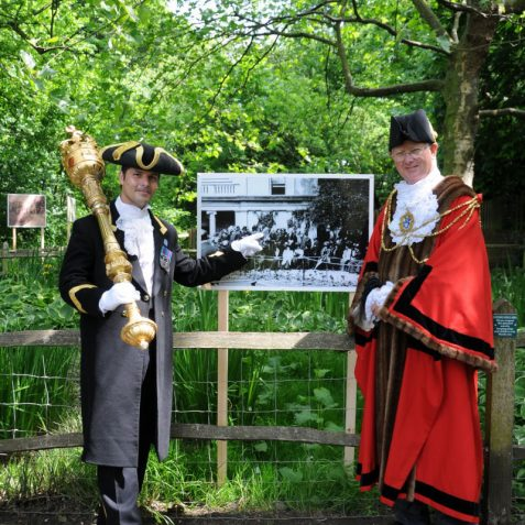 The Mayor and his Mace Bearer pose before a photo of the original opening ceremony | Photo by Tony Mould