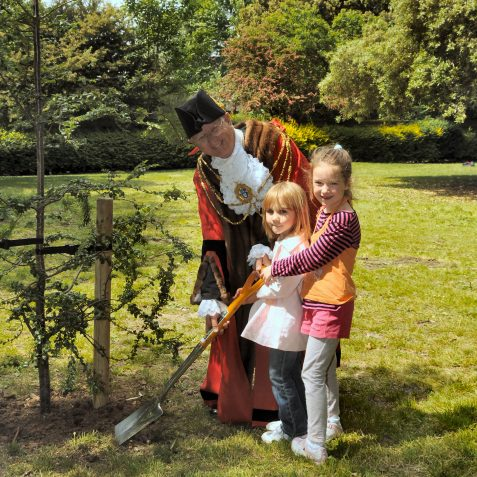 Helped by Isobel Stoner and Alice Micheson, the Mayor plants a commemorative tree | Photo by Tony Mould