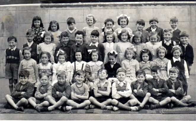 1950 or '51, I am seated 2nd from left, Janet Hill 2nd row 2nd from rt. Boy with withered arm 3rd row 5th from left   From the private collection of C. West
