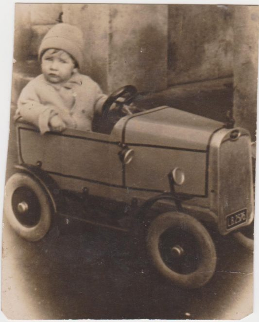 Stanley in his car | From the private collection of Joy Panteli