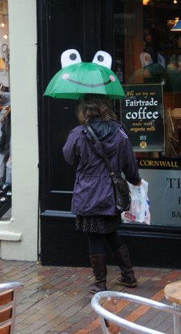 This lady is keeping dry and giving the rest of us a smile! | Photo by Tony Mould