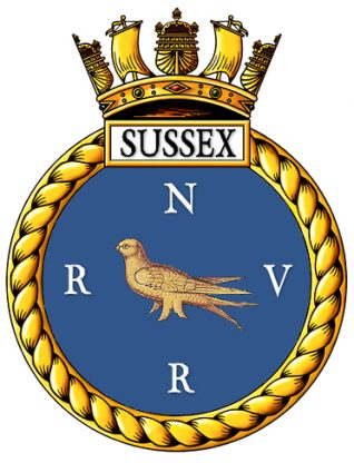 The Ship's badge for HMS SUSSEX - this is the sane design as issued to the WW2 Cruiser of that name but with the letters RNVR added to indicate the establishments reserve function.   Artwork by Tony Drury