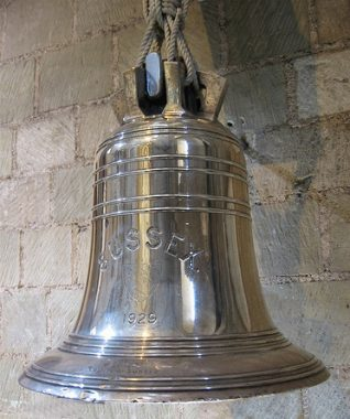 The Ship's bell from H.M.S. Sussex in Chichester Cathedral where it is currently on display.   From a private collection