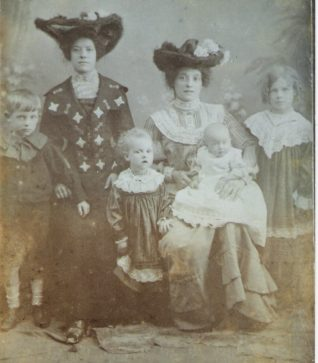 Photo shows Annie(seated with baby)and four of her eight children. Also, standing, her younger sister Kate Louise, who died shortly after this photo was taken. | From the private collection of Jane Hanick